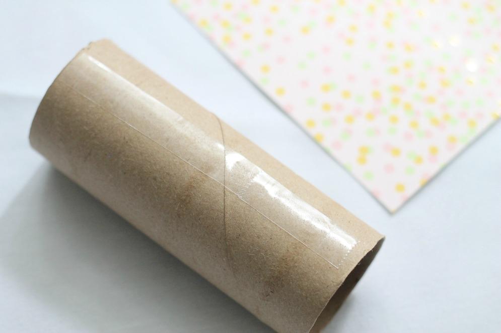 DIY-Confetti-Popper-securing-scrapbook-paper